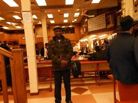 Serge Etele at the Chabad headquater in Brooklyn for Mincha prayer and study. (Photo credit: Rabbi Gerald Sussman)