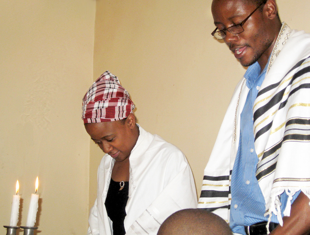 Brenda Maeresera and her husband, Modreck Maeresera, leading a service for the Harare Lemba Jewish community in Zimbabwe (Photo by IRWIN AND ELAINE BERG)