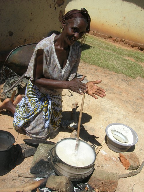 Lemba woman cooking over an open fire Photo by Sandy Leeder