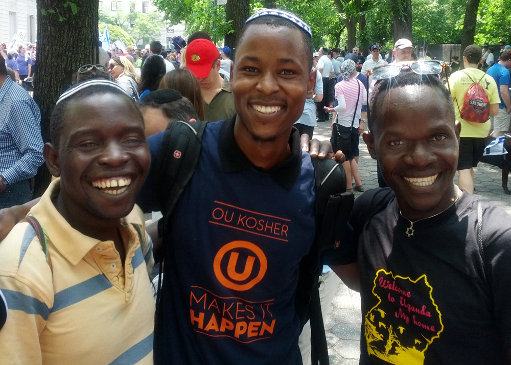 Three young men from Uganda (left to right): Yoash Mayende (BCI 2013), Moshe Kase, and Rachman Nachman (BCI 2015), enjoying the Israel Parade in New York City before BCI 2015(Photo by RACHMAN NAGWERE)