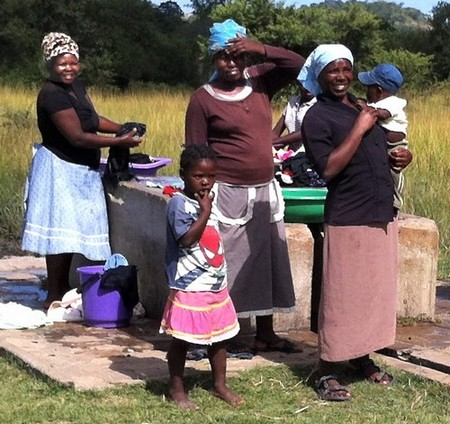 Lemba women gather at the local water hole to do their laundry Photo by Jack Zeller