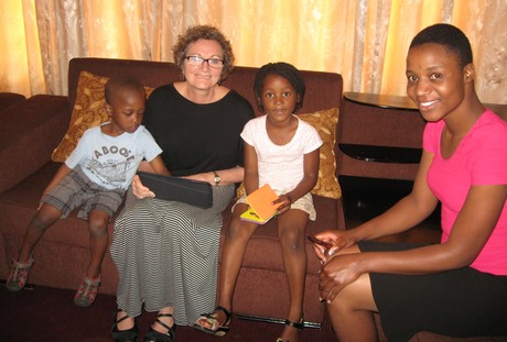 A quiet moment. With Elaine are Trecy, far right, her daughter Nyasha and Modreck's son Aviv (Photo by Modreck Maeresera)