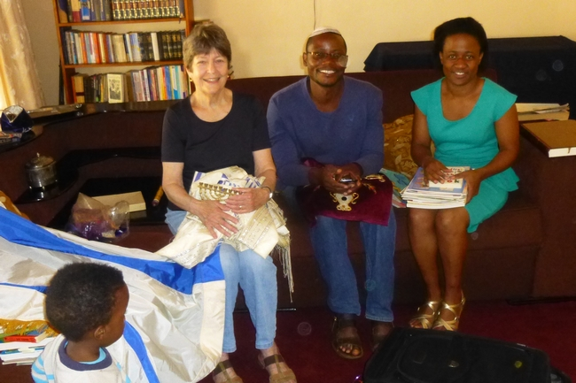 Gifts from Boston. Mickey delivers Jewish ritual objects to Brenda and Modreck collected by Kulanu Board member Judy Manelis for the Lemba Community House (Photo courtesy of Mickey Feinberg)