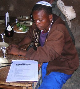 Young man at the Lemba Passover Seder in Mapakomhere, Zimbabwe Photo by Sandy Leeder