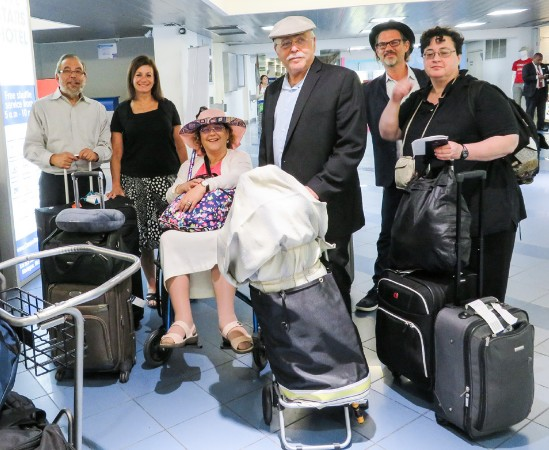 A tired but eager group arriving in Nicaragua with a gift of aTorah (center front, wrapped up)! From left to right: Rabbi Mark Kunis and wife Cheryl of Georgia; Rabbi Bonita Sussman and husband Rabbi Gerry Sussman of New York; Rabbi Marc Philippe of Florida; Dr. Marla Brettschneider of Massachusetts