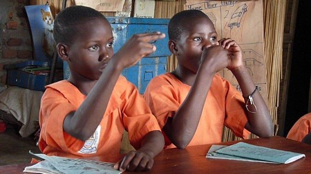 Kavule students practicing sign language Photo by Lorne Malli