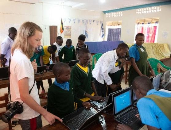 Computer coding class at Hadassah School in Uganda led by bar mitzvah student Logan